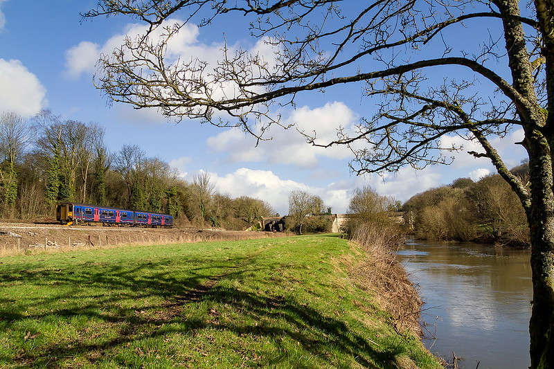 7th Feb 2017:  Slowing for the stop at Avoncliff is 2O89 the10.41 Gloucester Weymouth.  The background bridge carries the Kennet and Avon Canal over the railway and the River Avonj