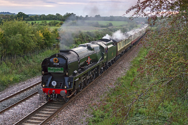 23rd Sep 2017:  35028 'Clan Line' powering the the ACE railtour from Victoria to Exeter St Davids went the correct way using  the LSWR from Basingstoke.  However the return was routed  via Taunton, Westbury, Swndon and Reading.  The train timing meant that the sun locally was in the wrong place but with my limited time and transport Fairwood was my only option.  To make a change the train is pictured from the north side of the bridge.