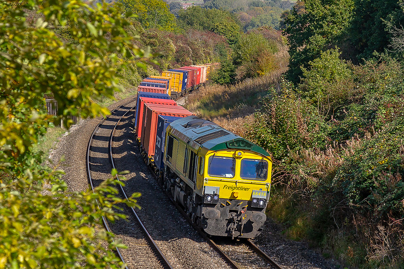 19th Oct 2018:  Drifting down the grade through Shockerwick, just East of Box, is 66416 on the point of 4V31 from London Gateway to Bristol Freightliner Terminal