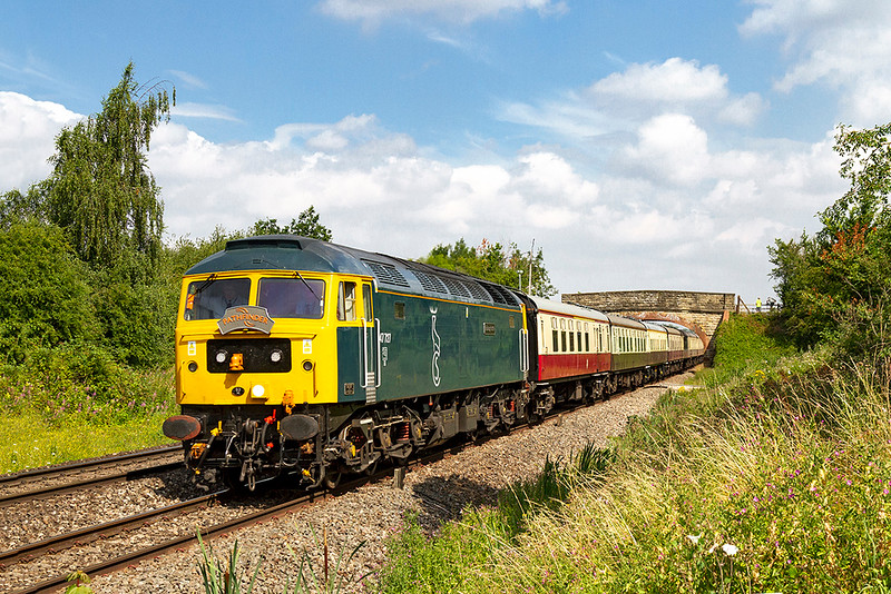 21st Jul 2018:  Pathfinder Tours 'The Solent and Sussex Explorer' is powered by ex Colas 47727 'Rebecca' that is now part of the GBRf fleet.  Now repainted into Caledonian Sleeper livery and renamed 'Edinbugh Castle' it is working the tour 1Z53 from Cardiff to Portsmouth and Littlehampton.  Running 14 minutes early it is pictured as it passes through Heywood with the Church Road bridge in the background.