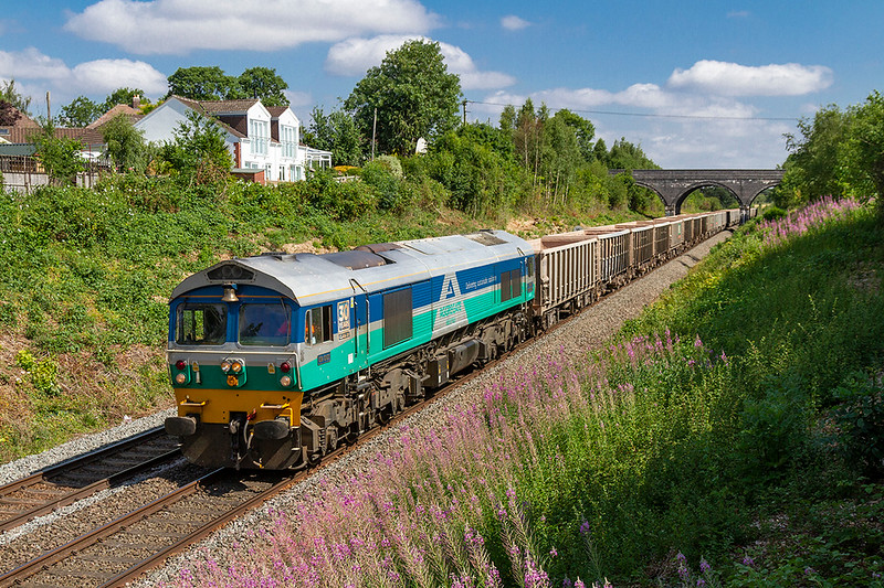 10th Jul 2018:  Running down the Frome Avoider passed the Rosebay Willowherb is the late running 7C29 from Acton to Merehead.  It is alway good to get a picture of tyhe iconic 59001 particularly with the 'Bell' end leading