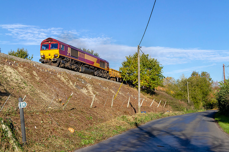 31st Oct 2018:  66060 is working hard as it climbs through Penleigh, near Dilton Marsh, as it works 6O41 the morning departmental service from Westbury to Eastleigh.  This section of line is suffering  from the badgers that live in the embankment,  When a one of the tunnels that they create collapses due to train weight the line dips.  Here the entrances have been given 'one way' doors so that when the badgers leave they cannot return.  This is being undertaken with full environmental authority.
