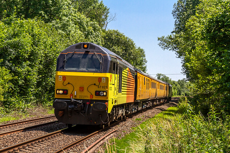 28th Jun 2018:  At Sherrington Lane in the Wylye Valley are 67023 TnT 67027 as they work !Q23 from Salisbury to Westbury. This is one leg of the days effort that started and ended in Reading and encpmpassd Exeter and Southampton.