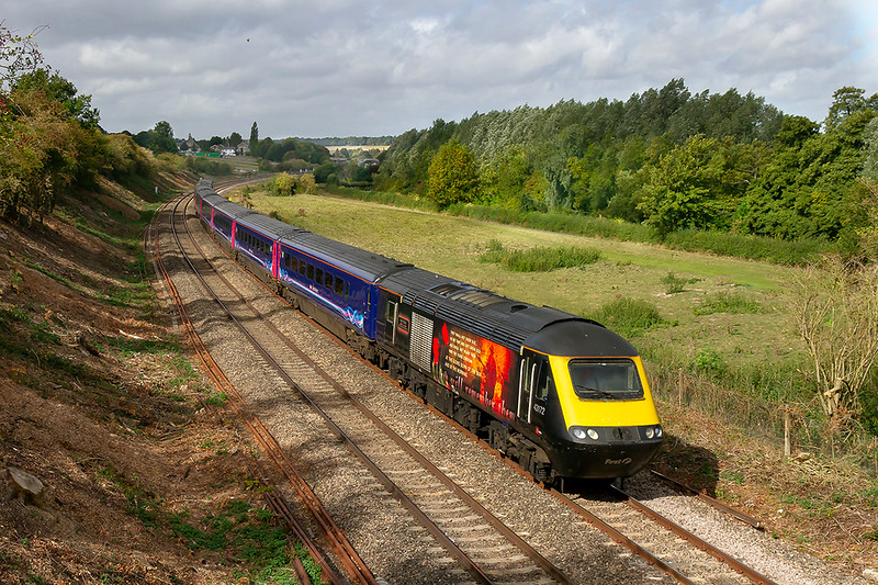 19th Sep 2018:  Vinyl HST power cars  are becomming rare as  as the HSTs are taken off lease.  43172 'Harry Patch' is leading on 1A79 the 06.47 from Penzance to Paddington at Hungerford.  The Kennet and Avon Canal is out of sight behind the  hedge on the right.