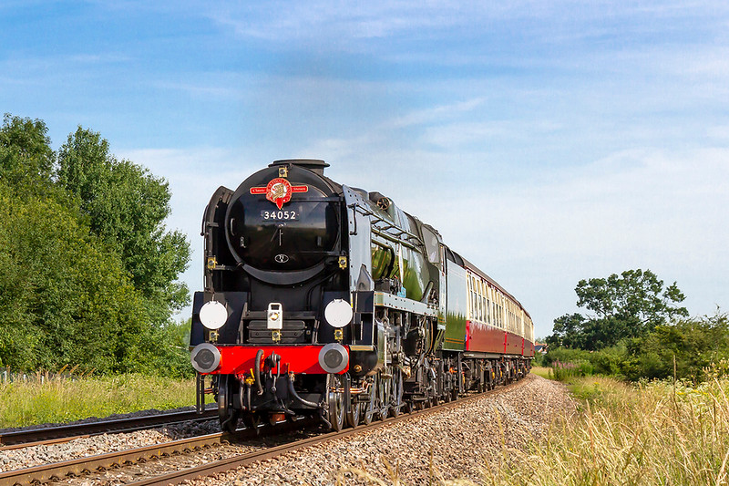 """24th Jun 2018:  Carrying thre 'Saphos Trains Classic Steam' headboard Southern Railway BB class 34052 """"Lord Dowding', actually it is 34046 'Braunton', powers passed the White Horse Business Park near Trowbridge as it works 1Z17 The English Riviera Express.  Starting from Bristol Temple Meads it is going to the end of the Dart Valley Railway at Kingswear."""