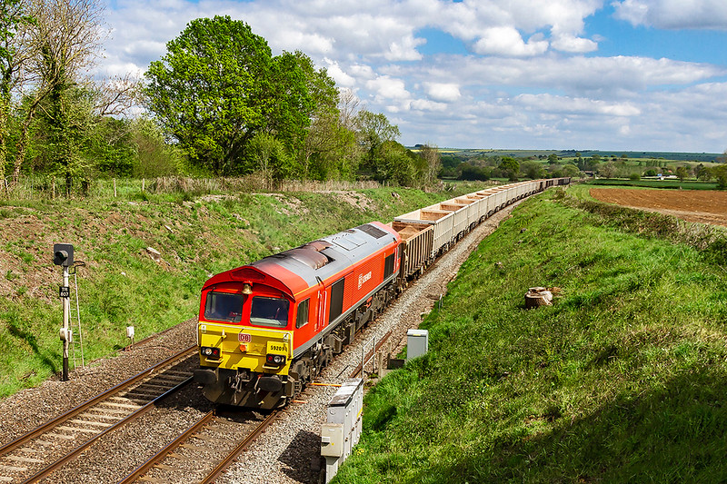 29th Apr 2019:  With the bell end leading 59201 which is working 7C77 from Acton to Merehead Quarry, makes a fine sight as it nears  the 'Wichcombe Way' bridge in Great Cheverell.  The purpose of the visit to this spot was to snap 43185 heading west in the sun. Unfortunately that was obscured buy a big black cloud.
