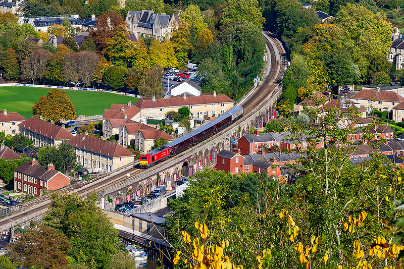 15th Oct 2019:  67015 is leading on 1Z06 which is the return of yesterday's DBC executives train from Toton to Westbury.  Starting from Westbury at 13.17 one minute early it is pictured from Alaxandra Gardens as it is about to pass through Bath Spa station now 5 minutes  early. The River Avon is just visible at the bottom of the frame.