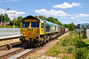 1st June 2020:  7V72  from Southampton Up Yard (Bevois Park) to Whatley Quarry  powered by 66564  it is passing through Warminster Station on another lovely sunny day