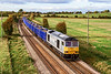 8th Oct 2020:    In a very fortunate patch of sun shine DC Rail 60029 'Ben Nevis' is heading to Southampton Up Yard with 6Z91 the 16.28 fron Westbury. with a load of spent ballast ..  The picture  is taken from the northern bridge over the line on the Warminster Bye Pass