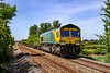 28th May 2020:  Nearing Warminster is 66504 in Power Haul livery on the front of 4O57 from Wentloog to Southampton MCT.  As usual during  Carona epidemic all ther containers were on the second half of the train.  The picture is taken from  a foot crossing and a power line has been cloned out of the frame.