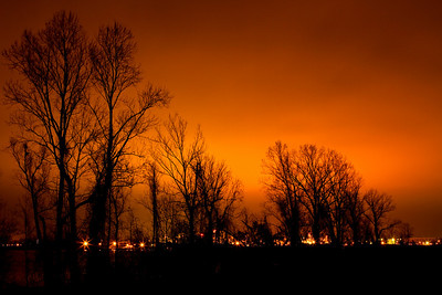 """Fire in the sky"".  The foggy sky over the Mississppi is lit up by a distant refinery.  Taken near Luling, louisiana"