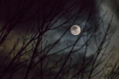 full moon  cloudy winter evening