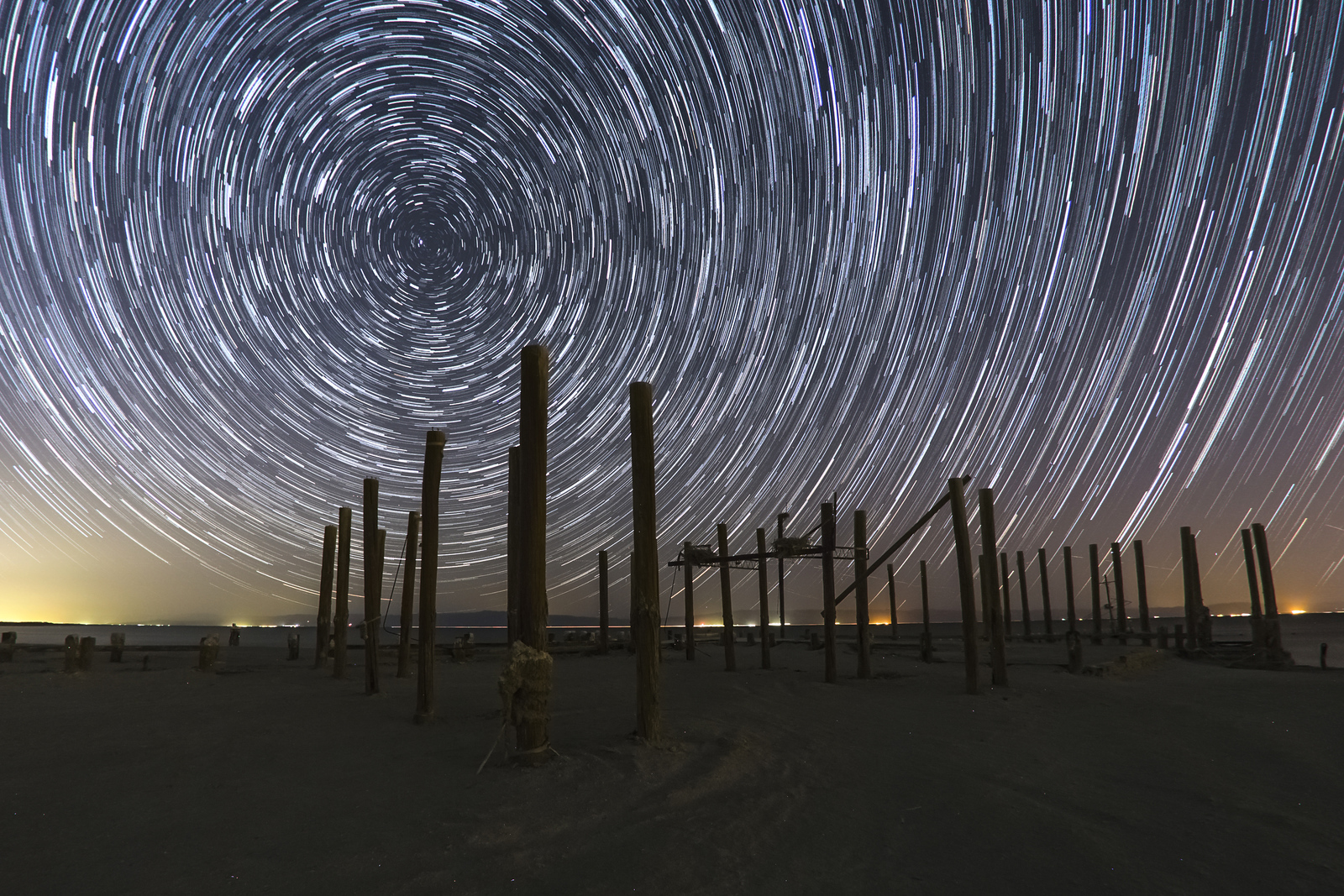 Star Trails and Pilings from an Old Pier at the Salton Sea Naval Station.