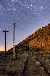 Telephone pole, semaphore, and moonlit train tracks in Carrizo Gorge