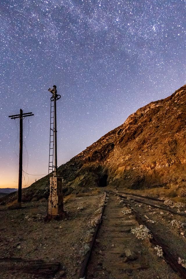 Telephone pole, semaphore, and moonlit train tracks in Carrizo Gorge