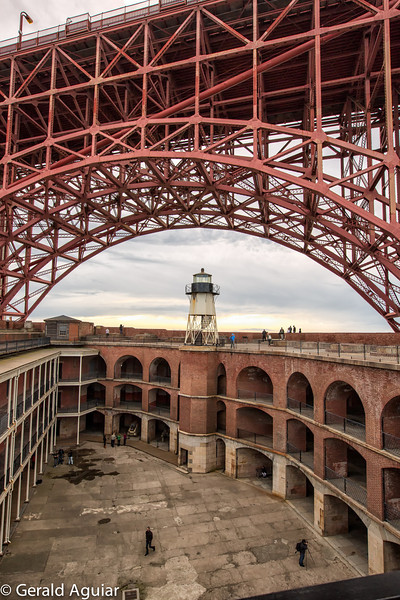 I really like the detail of this photo of the courtyard of Fort Point.  There is a photographer from our group using his tripod in the right lower corner of this picture.  I believe the small lighthouse at the other end of the fort was probably some of the original equipment here.  Notice how the bridge was built to spare Fort Point.
