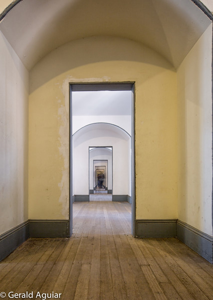 This hallway is on the second floor of Fort Point.  The exposure was about 6 seconds long.  I was not able to take a photo without someone being in the hallway (notice the blur in the middle of the hallway).