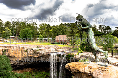 Statue of Noccalula with the falls in the background - horizontal