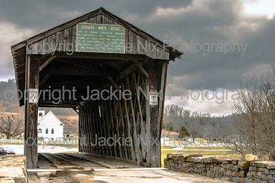 Looking through Goddard White Bridge to church