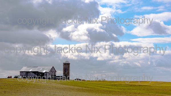 Barn and silo on top of a hill