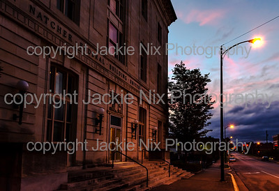 Courthouse lit by a streetlamp at blue hour