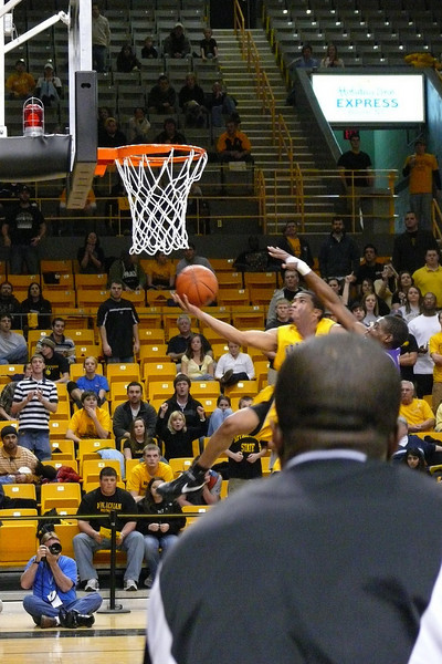 Sorry - the players on the bench would stand up for the really exciting fast breaks and dunks like this one.