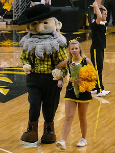 During a time-out, Yosef and a cheerleader will give a rose to a young female fan - this day they chose my daughter!