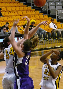 Forward #34 Brittany Mixon fights hard under the basket.