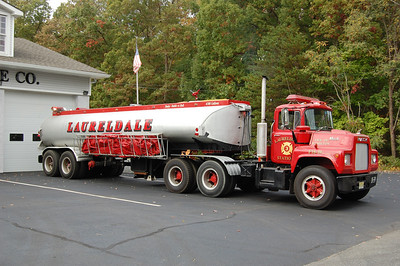 Lauredale Fire Co., Station 3 in Hamilton Twp. Tanker 18-39, a 1975 Mack / 1959 Fruehauf 500 / 6500.  Photo by Chris Tompkins