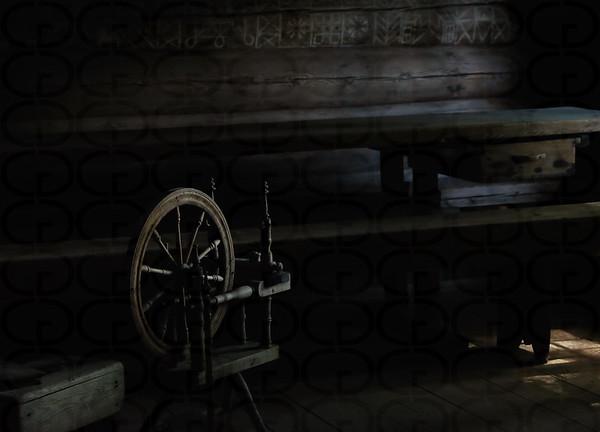 Spinning Wheel in an Unlit Hut