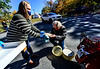 Brooks Ditto, of Nashville, Tenn., brings six apple pies to Doug Smith, of Wrentham, Mass., who drove up to the 51st annual Dummerston Apple Pie Festival, in Dummerston, Vt., to bring the pies home on Sunday, Oct. 11, 2020. The Apple Pie Festival was modified to be a drive-thru style because of the COVID-19 pandemic canceling many Fall festivals. The Apple Pie Festival is an annual fundraising event for the Dummerston Congregational Church, UCC.