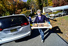 Cathy Miller, of Dummerston, Vt., brings a tray of apple pies to a vehicle during the 51st annual Dummerston Apple Pie Festival, in Dummerston, Vt., that was held as a drive-thru style event because of the COVID-19 pandemic on Sunday, Oct. 11, 2020. The Apple Pie Festival is an annual fundraising event for the Dummerston Congregational Church, UCC.