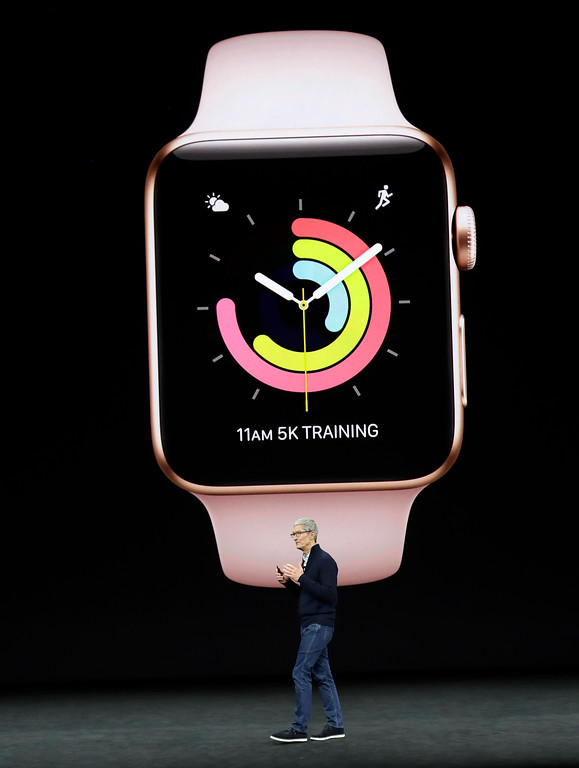 . Apple CEO Tim Cook shows new Apple Watch products at the Steve Jobs Theater on the new Apple campus on Tuesday, Sept. 12, 2017, in Cupertino, Calif. (AP Photo/Marcio Jose Sanchez)
