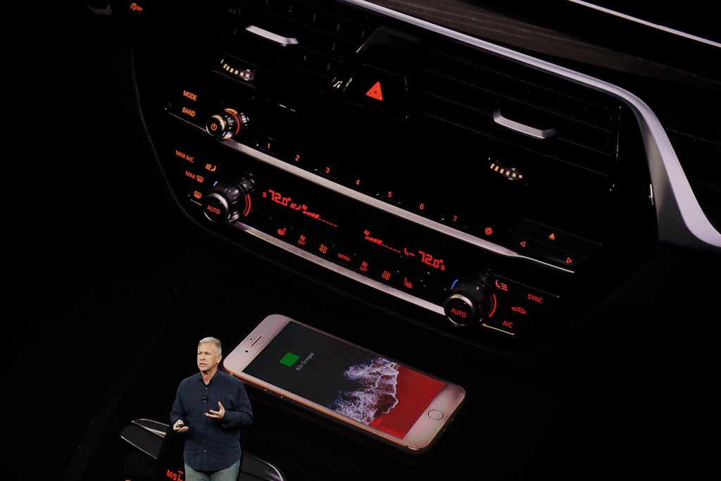 . Phil Schiller, Apple\'s senior vice president of worldwide marketing, announces features of the new iPhone 8 at the Steve Jobs Theater on the new Apple campus on Tuesday, Sept. 12, 2017, in Cupertino, Calif. (AP Photo/Marcio Jose Sanchez)