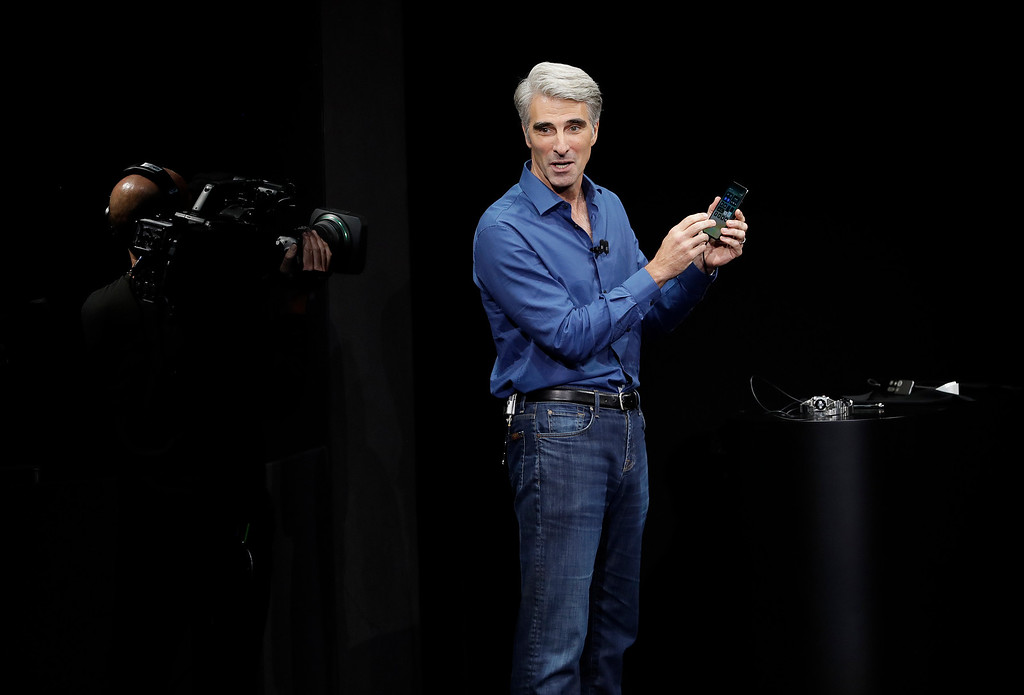. Craig Federighi, Apple\'s senior vice president of software engineering, discusses features of the new iPhone X at the Steve Jobs Theater on the new Apple campus on Tuesday, Sept. 12, 2017, in Cupertino, Calif. (AP Photo/Marcio Jose Sanchez)