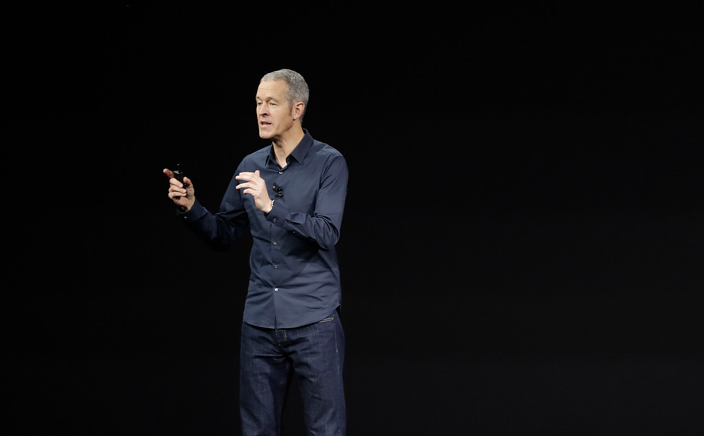. Jeff Williams, Apple\'s chief operating officer, shows new Apple Watch products at the Steve Jobs Theater on the new Apple campus on Tuesday, Sept. 12, 2017, in Cupertino, Calif. (AP Photo/Marcio Jose Sanchez)