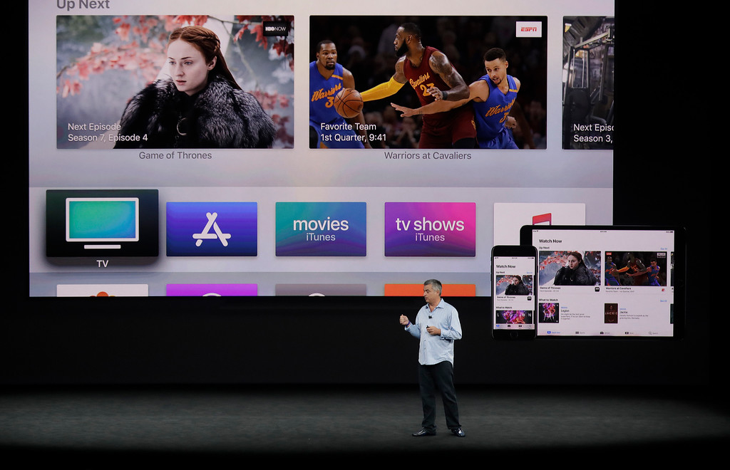 . Eddy Cue, Apple\'s senior vice president of internet software, shows the new Apple TV product at the Steve Jobs Theater on the new Apple campus on Tuesday, Sept. 12, 2017, in Cupertino, Calif. (AP Photo/Marcio Jose Sanchez)