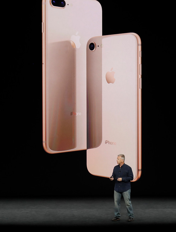 . Phil Schiller, Apple\'s senior vice president of worldwide marketing, shows the new iPhone 8 at the Steve Jobs Theater on the new Apple campus on Tuesday, Sept. 12, 2017, in Cupertino, Calif. (AP Photo/Marcio Jose Sanchez)