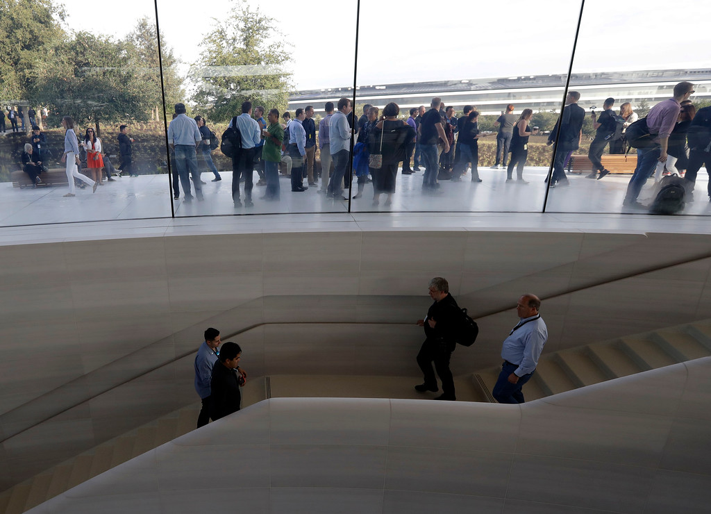 . People arrive for a new product announcement at the Steve Jobs Theater on the new Apple campus, Tuesday, Sept. 12, 2017, in Cupertino, Calif. (AP Photo/Marcio Jose Sanchez)