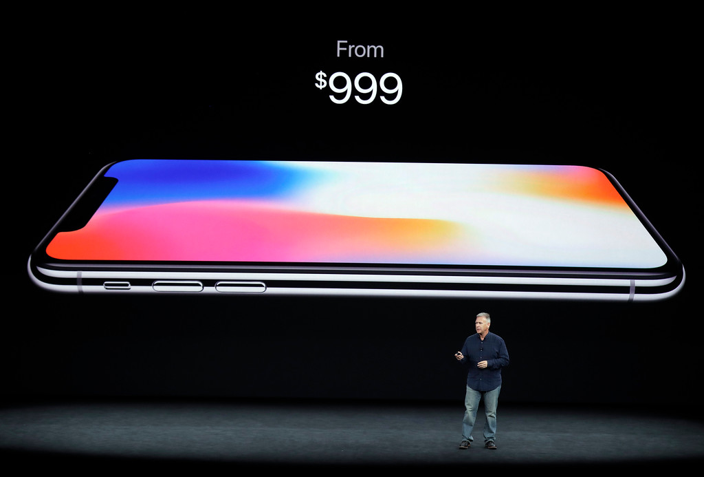 . Phil Schiller, Apple\'s senior vice president of worldwide marketing, discusses features of the new iPhone X at the Steve Jobs Theater on the new Apple campus on Tuesday, Sept. 12, 2017, in Cupertino, Calif. (AP Photo/Marcio Jose Sanchez)