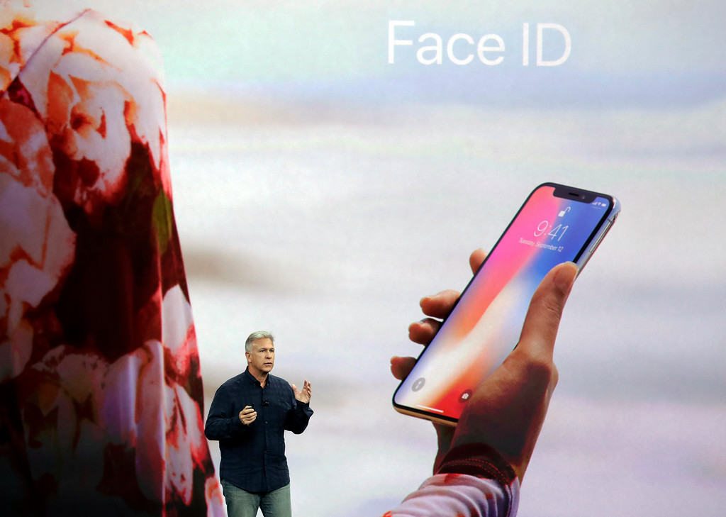 . Phil Schiller, Apple\'s senior vice president of worldwide marketing, announces features of the new iPhone X at the Steve Jobs Theater on the new Apple campus on Tuesday, Sept. 12, 2017, in Cupertino, Calif. (AP Photo/Marcio Jose Sanchez)