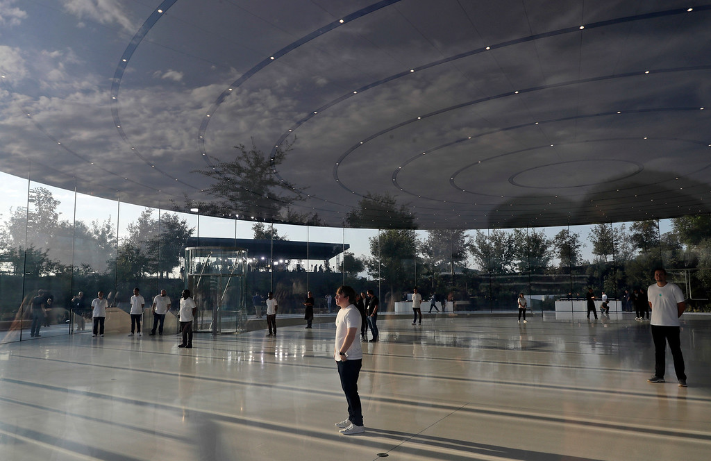 . Employees wait for people to arrive for a new product announcement at the Steve Jobs Theater on the new Apple campus, Tuesday, Sept. 12, 2017, in Cupertino, Calif. (AP Photo/Marcio Jose Sanchez)
