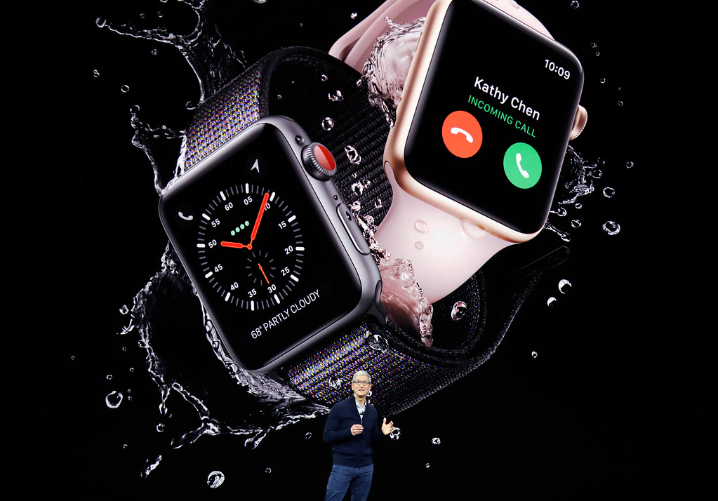 . Apple CEO Tim Cook, shows new Apple Watch Series 3 product at the Steve Jobs Theater on the new Apple campus on Tuesday, Sept. 12, 2017, in Cupertino, Calif. (AP Photo/Marcio Jose Sanchez)