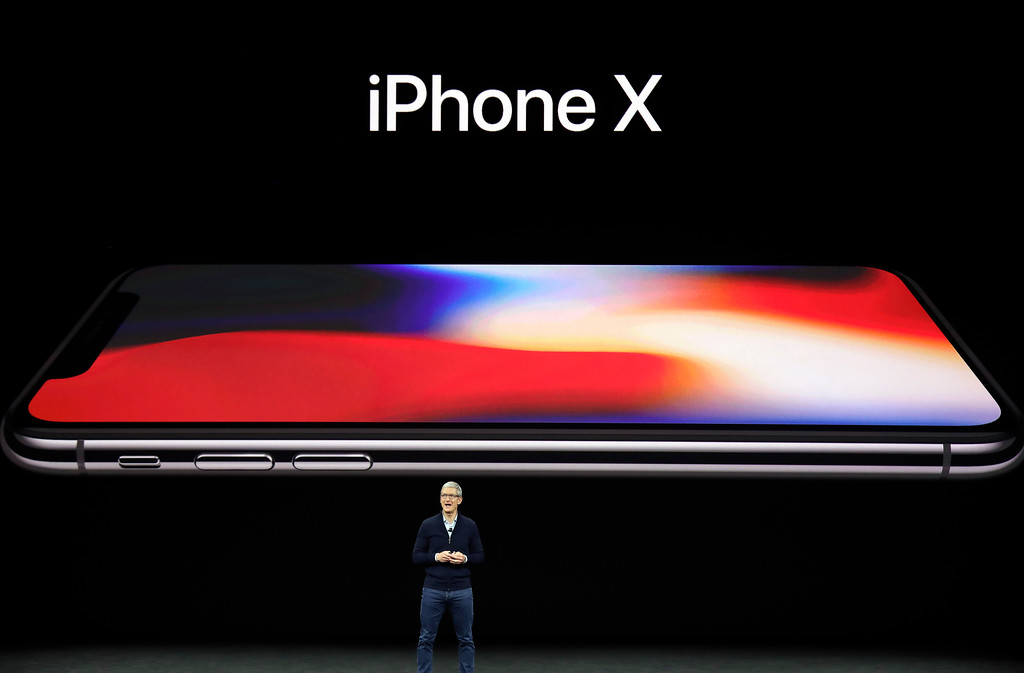. Apple CEO Tim Cook announces the new iPhone X at the Steve Jobs Theater on the new Apple campus, Tuesday, Sept. 12, 2017, in Cupertino, Calif. (AP Photo/Marcio Jose Sanchez)
