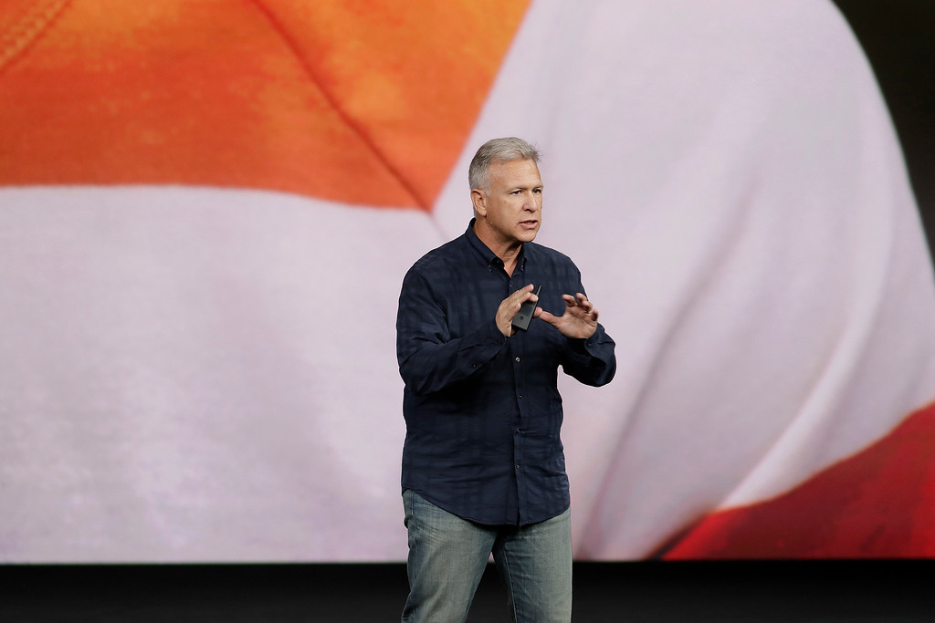 . Phil Schiller, Apple\'s senior vice president of worldwide marketing, shows features of the new iPhone 8 at the Steve Jobs Theater on the new Apple campus on Tuesday, Sept. 12, 2017, in Cupertino, Calif. (AP Photo/Marcio Jose Sanchez)