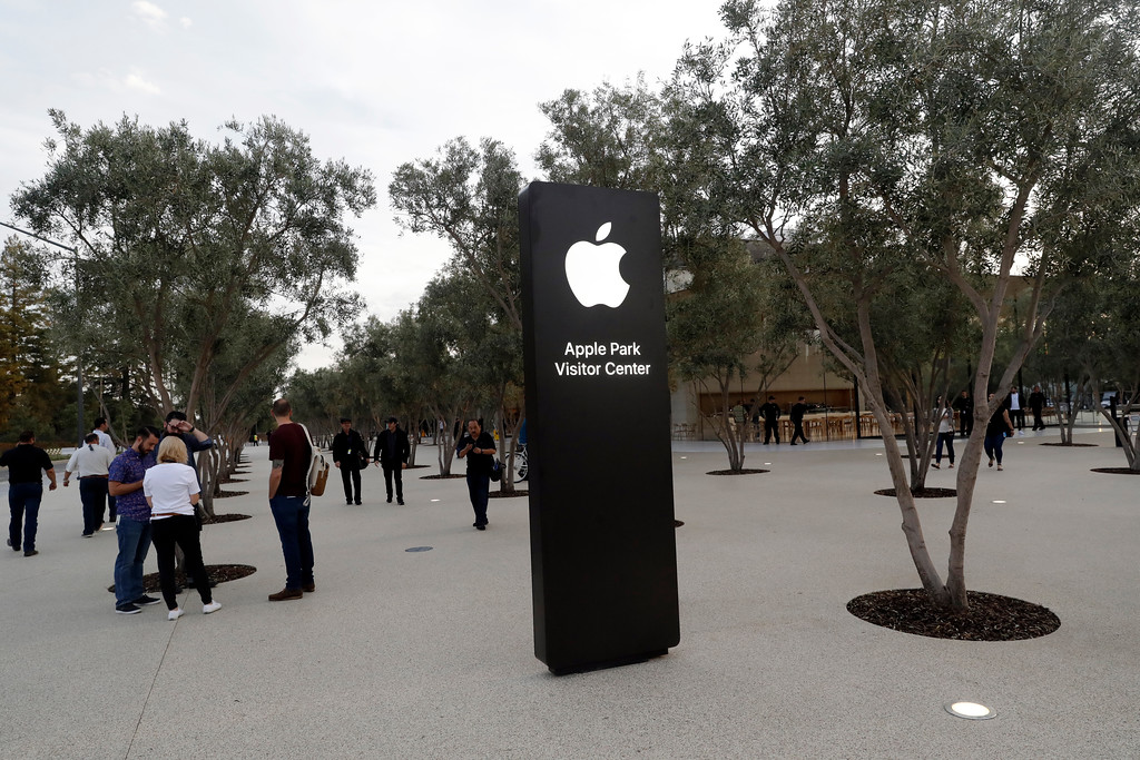 . An exterior view of Apple\'s new visitor center during an announcement of new products Sept. 12, 2017, in Cupertino , Calif. (AP Photo/Marcio Jose Sanchez)