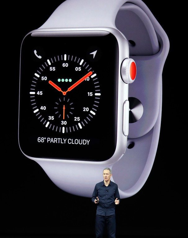 . Jeff Williams, Apple\'s chief operating officer, shows new Apple Watch Series 3 product at the Steve Jobs Theater on the new Apple campus on Tuesday, Sept. 12, 2017, in Cupertino, Calif. (AP Photo/Marcio Jose Sanchez)