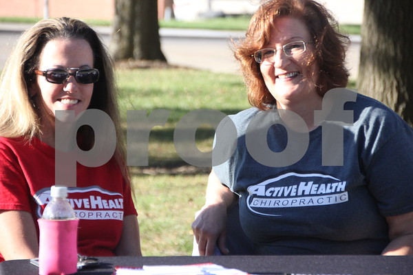 The town square in Fort Dodge was  the kick off point of the annual  Applefest 5k/10k run taking place on Sunday, September 27, 2015. Just some of several volunteers  helping out with the event are pictured here. They are left to right: Jeannie Rossow and Ann Halbur. They are with Active Health Chiropractic.