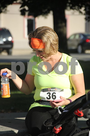 Seen pictured is: Gina Christoffel before she starts the annual Applefest 5k/10k run  taking place at the Fort Dodge town square on Sunday, September 27, 2015.
