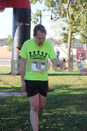 Crossing the finish line  at the Fort Dodge  annual  Applefest 5k/10k run is :Jordon McCubbin. The event  kicked off at town square on Sunday, September 27, 2015.